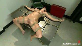 Tied up busty oiled brunette with gag in her mouth is analfucked mish