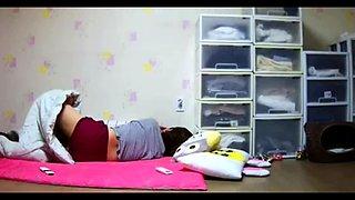 Masturbation of a Korean Stepmom on spy camera