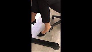 Secretary in tan nylon socks and black heels