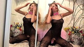 Cutie in crotchless pantyhose masturbates in front of mirror