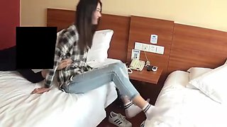 Chinese girls wear white socks with two black bars.Man tickle her feet.