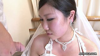 Naughty and quite buxom Japanese bride Emi Koizumi gives a good blowjob
