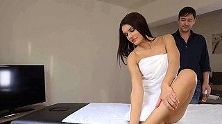Beautiful brunette rides masseuse cock