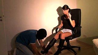 Dominant brunette babe makes her slave clean her black boots