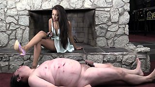 Sexy slender brunette dominatrix punishes her chubby slave