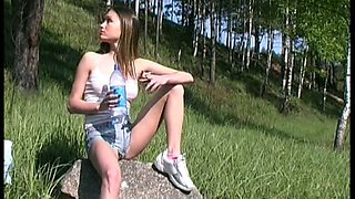 Spoiled leggy young chick pulls her shorts down to pee a bit