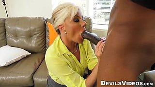 Grandma has skills when she starts sucking on a black cock