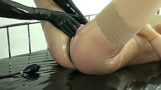 Rubber Girl Fucked With Dildo In Transparent Latex Catsuit + Mask + Gloves