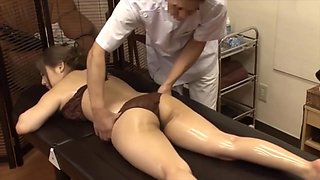 Masseur secretly fucked with hot wife next her husband