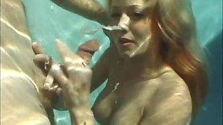 Bitch sucks dick underwater in the pool