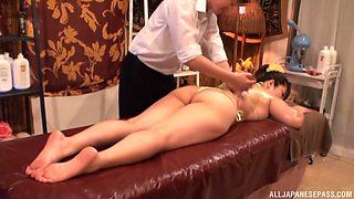 Oiled cunt of chubby Asian is everything her masseur wants to touch