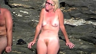 Naked blonde milf on the beach has a nice ginger bush