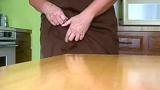 Horny pleasure seeking MILF is having some naughty fun with the kitchen table
