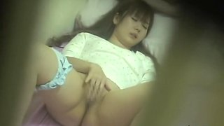 Charming Japanese cutie plays with pussy on a spy camera