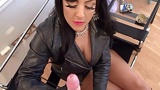 British mistress in leather gives her slave handjob finish