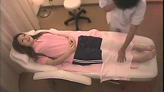 Beautiful Japanese tramp fucking at a massage parlor