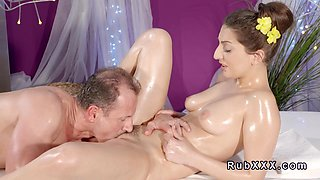 Oiled brunette banged till creampie by masseur