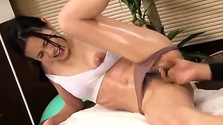 Pretty Asian girl with lovely tits gets massaged and fucked
