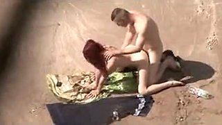 Voyeur Spying Web Camera Caught Redhead Woman Fucking on Beach