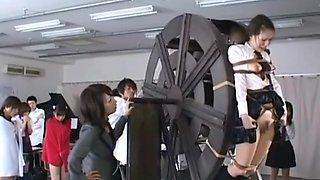 japanese schoolgirls punished on waterwheel